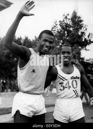 Jun 31, 1968; Paris, France; Runner ROGER BAMBUCK sets a 100 meter record, pictured with ENRIQUE FIGUEROLA. - Stock Image