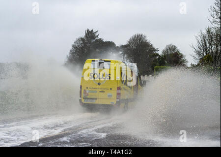 Skibbereen, West Cork, Ireland. 15th Apr, 2019. Much of Ireland is currently in the midst of a Status Orange Rainfall Warning, issued by Met Éireann. A van races through a spot flood on the N71 near Skibbereen. Credit: Andy Gibson/Alamy Live News - Stock Image