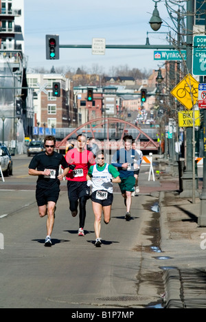 Running of the Green footrace held in the LoDo area of downtown denver - Stock Image
