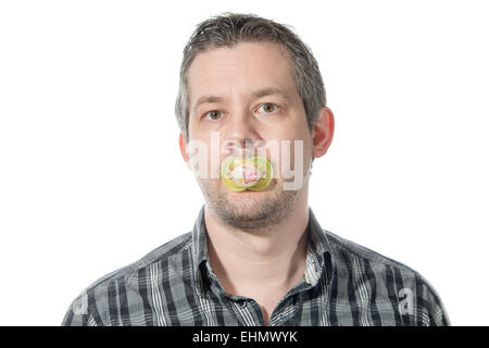 Picture of a man sucking on a pacifier - Stock Image