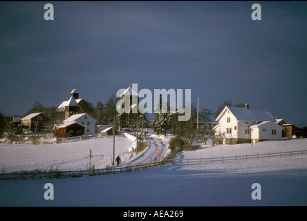 Norwegian landscape with small contryside town with snow in winter in southern Norway - Stock Image