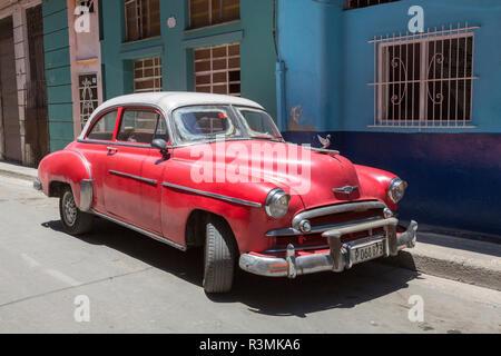 Cuba, Havana. Parked classic red car. Credit as: Wendy Kaveney / Jaynes Gallery / DanitaDelimont.com - Stock Image
