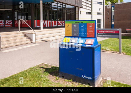 Recycling point on university campus with separate bins for litter, paper, cans and plastic bottles - Stock Image