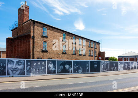Hoardings showing 1960's pop images Rock Legends by Paul Berriff  on Former Prison in Northallerton Yorkshire to be converted for a new development - Stock Image
