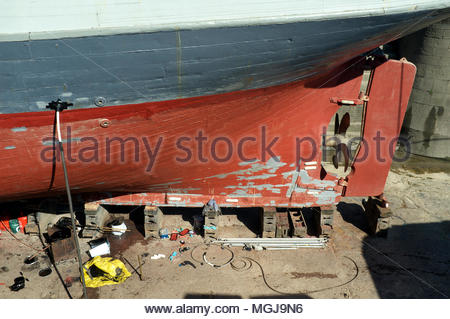 T.Nielsen & Company - traditional ship builders and riggers. The lower stern area of the Kaskelot in the Gloucester docks shipyard. Gloucester, UK. - Stock Image