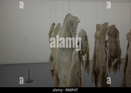 A close shot an art installation of cowhide skins in the shape of human bodies by NANDIPHA MNTAMBO at the Zeitz MOCCA museum of African art in Cape To - Stock Image