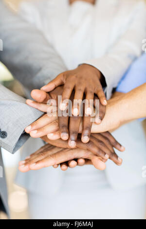 close up of business people hands together - Stock Image
