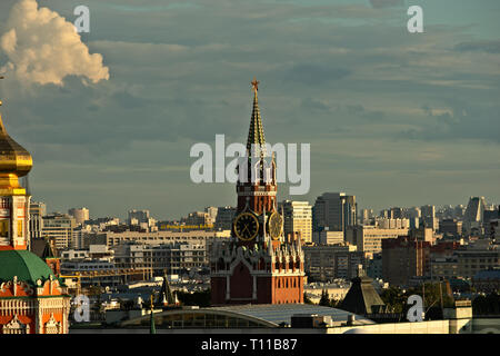 MOSCOW, AUGUST 7, 2018: Beautiful view of Moscow city and Spassky – Savior's – tower of Moscow Kremlin at summer sunset. Horizontal photo - Stock Image