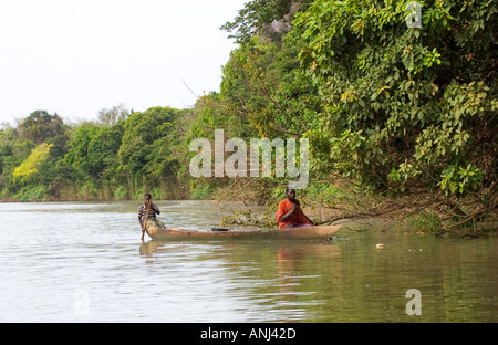 Father and son returning home after a day fishing on the Black Volta river north western Ghana - Stock Image