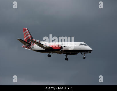 Scottish airline operated by Logan airways Saab34B in its tartan livery arriving at Inverness Dalcross airport. - Stock Image