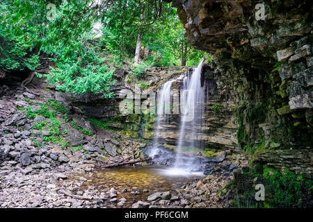 Waterfalls and green moss covered shale rock formation from Niagara Escarpment in Conservation Hilton,Milton, Ontario, Canada - Stock Image
