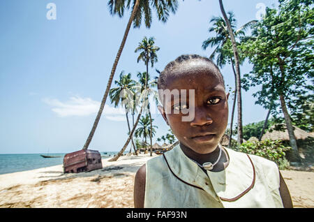 Girl on the beach on Sei Island, the Turtle Islands, Sierra Leone. - Stock Image