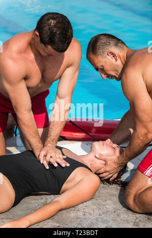 Lifeguards in CPR training. - Stock Image