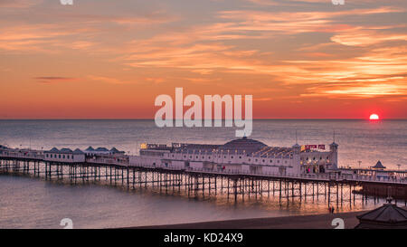 View of a sunset on the beach in Brighton - Stock Image
