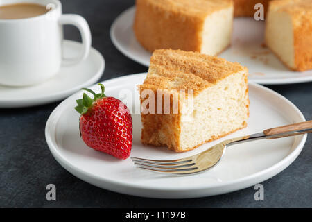 Portion of angel food cake served with strawberries - Stock Image