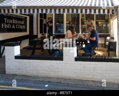Silver Street Fisheries Traditional Fish and Chip Shop with outside seating in Silver Street Whitby North Yorkshire England - Stock Image