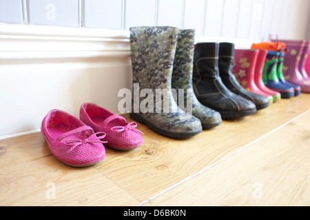 Childrens shoes lined up on floor - Stock Image