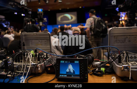 Cassini project scientist at JPL, Linda Spilker is seen on a monitor during a press conference held after the end - Stock Image