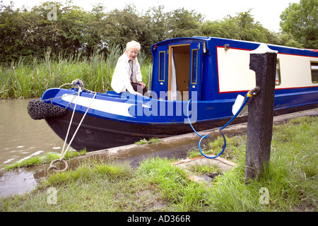 Narrowboat taking on water at a water point on the Ashby Canal - Stock Image