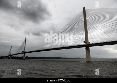 Modern Queensferry Crossing cable stayed suspension bridge over the Firth of Fourth to Edinburgh Scotland UK under stormy gray sky - Stock Image