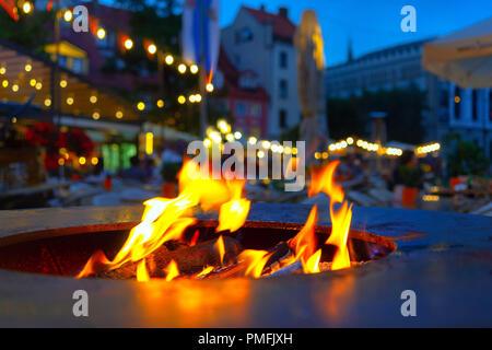 Fire in the stove in the square in Riga - Stock Image