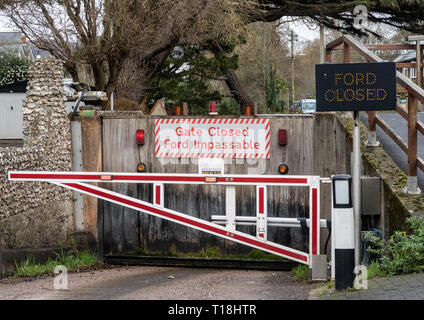Sign - gate closed, ford impassable, on the river Sid, at Sidmouth, Devon, UK - Stock Image