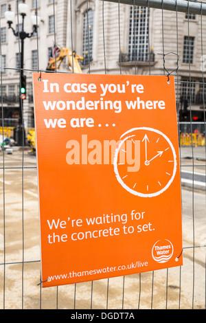 United Utilities sign for road work Regent Street London - Stock Image