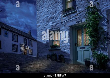 Dent village, Cumbria., Main street and Sun Inn. Photoshop nightime version. - Stock Image