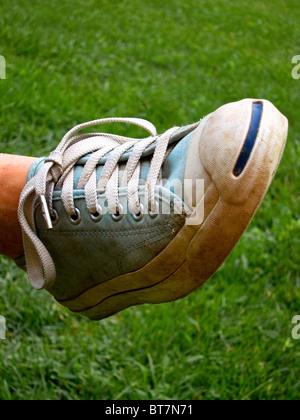 tight shot of cyan blue sneaker - Stock Image