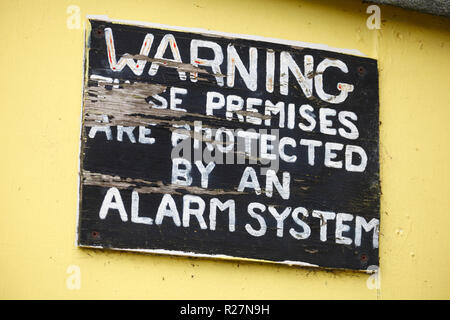 Warning these premises are protected by an alarm system. - Stock Image