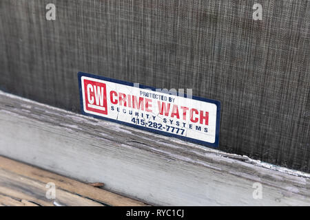 Protected by Crime Watch Security Systems, sticker on a window; San Francisco, California, USA - Stock Image