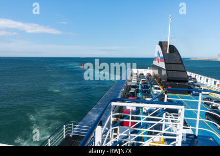 Bilbao, Spain, 7th March 2019. High winds and rough seas prevented the airlit of a lorry driver who had taken ill on board the Brittany Ferry Etretat as it was one and a half hours from the Spanish port of Bilbao on route to Portsmouth UK. The ship turned around and returned to port escorted by the coastguard cutter where the patient was taken away by ambulance. Credit: Mick Flynn/Alamy Live News - Stock Image