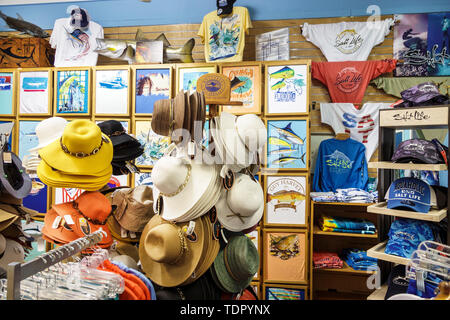 Sanibel Island Florida Footloose H2O Outfitters shopping sports outfitters hats clothes Salt Life fishing theme brand tee t-shirt Wallaroo hats - Stock Image