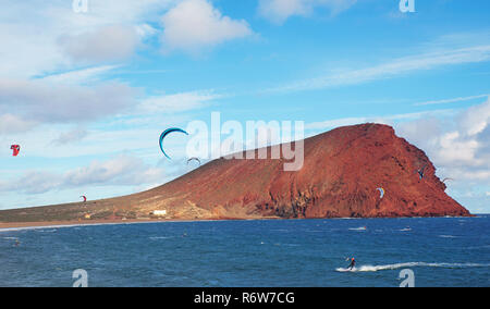 Sunny day on the beach of La Tejita, with the unusual, stratovolcanic cone named Montana Roja in the background, Tenerife, Canary Islands, Spain - Stock Image