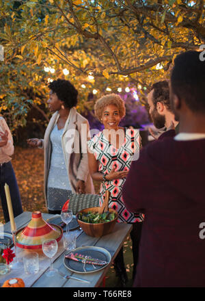 Friends talking at dinner garden party - Stock Image