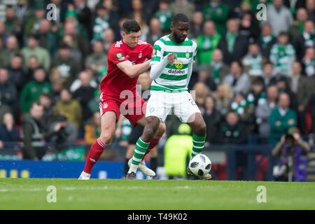 Hampden Park, Glasgow, UK. 14th Apr, 2019. Scottish Cup football, semi final, Aberdeen versus Celtic; Odsonne Edouard of Celtic and Scott McKenna of Aberdeen Credit: Action Plus Sports/Alamy Live News - Stock Image