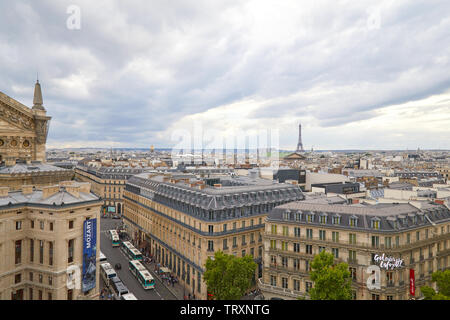 PARIS, FRANCE - JULY 22, 2017: Paris rooftops view and Eiffel Tower seen from Galeries Lafayette terrace in a cloudy day in France - Stock Image