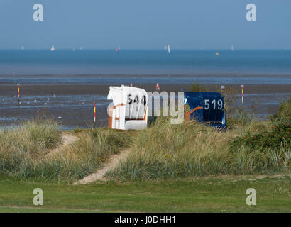 2 traditional german beach chairs at the North Sea - Stock Image