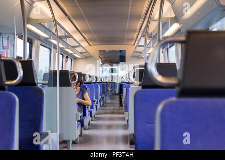A near empty modern electric train interior running between Thessaloniki and Larissa in Greece - Stock Image
