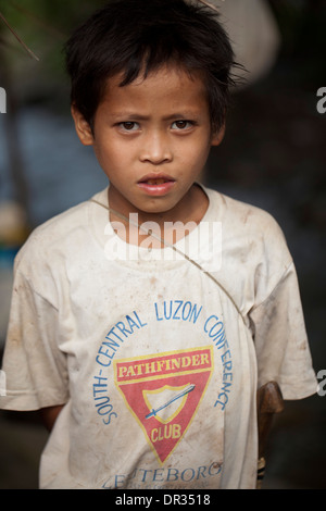 A Hanunoo Mangyan boy attending a Mangyan market near Mansalay, Oriental Mindoro, Philippines. - Stock Image