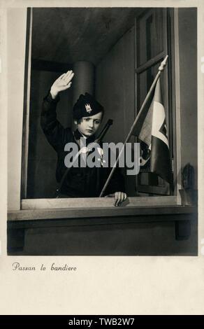 "WW2 - Fascist Italian Propaganda Postcard - Young Patriot saluting ""Passing the F;ags"".     Date: circa 1941 - Stock Image"