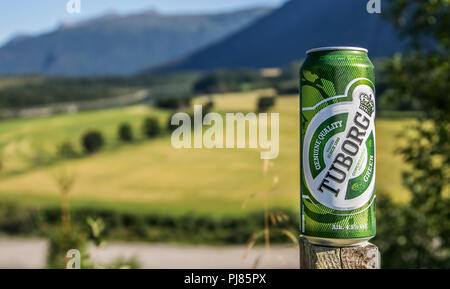 Norway, July 27, 2018: Can of Tuborg beer stands against beautiful natural backdrop. - Stock Image