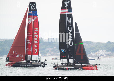 Portsmouth, UK. 23rd July 2015. Last years challengers for the trophy Oracle Team USA passes Emirates Team New Zealand - Stock Image