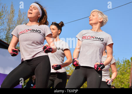 Nis, Serbia - April 20, 2019 Group of happy woman practicing Piloxing sport in an outdoor class in summer with instructor - Stock Image