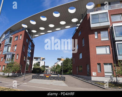 Contemporary Finnish architecture, a residential neighbourhood in the Skatudden harbour district of Helsinki Finland - Stock Image