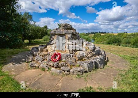 Poppleton war memorial for the fallen in both World Wars WWI WW1 WW2 WWII World War One World War Two, Nether Poppleton, near York, United KIngdom. - Stock Image