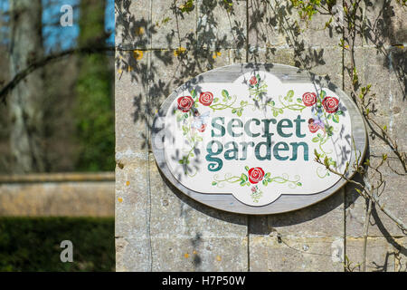 Secret garden sign on a wall. - Stock Image