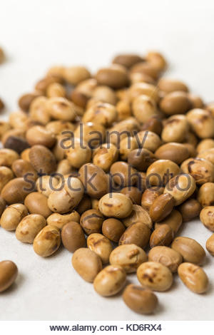 Closeup macro of soya beans on the white marble background. - Stock Image