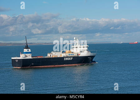 Sailing on the Orange line for Eimskip from Norway the Vessel 'Polfoss' departs Aberdeen for the North Sea. - Stock Image