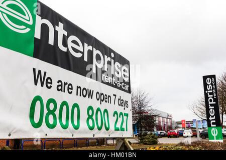 Enterprise rent a car rental business sign vehicle rental advert emblem signs UK - Stock Image